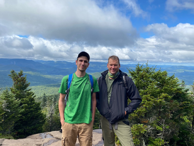 Dylan LaFave (left) and David Theobald (right) standing at the summit of Cascade mountain.